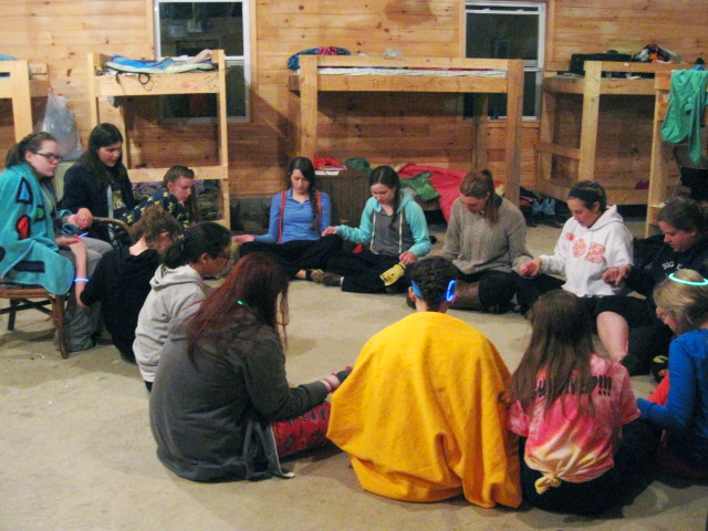 Girls Praying in Cabin